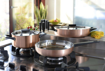 set of cookware on the hob