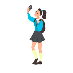 Young woman take selfie. Teenager blogging. Teen student takes a photo or video on the mobile phone. Girl takes pictures of herself on the front camera