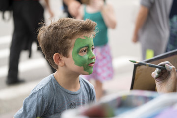 Kid covered with Face painting