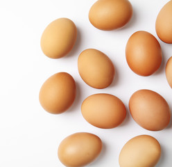 Raw chicken eggs on white background, top view
