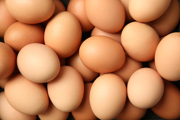 Pile of raw brown chicken eggs, top view