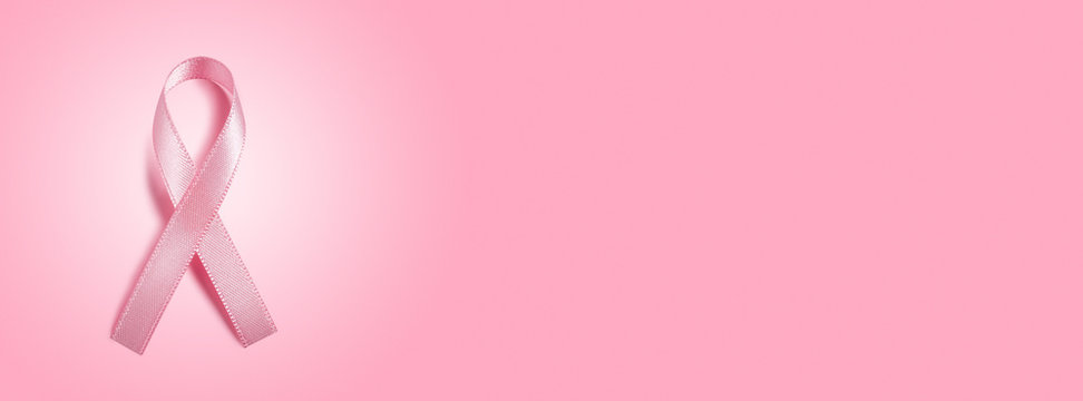 pink ribbon on pink background with copy space