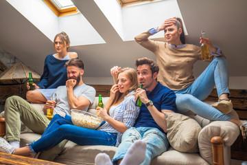 Friends watching football game