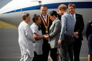 Britain's Prince Harry and his wife Meghan, Duchess of Sussex, arrive at Dubbo airport, Dubbo