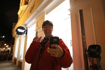 Ian Power takes a selfie outside the Tweed retail store as he lines up to purchase legal recreational marijuana in St John's