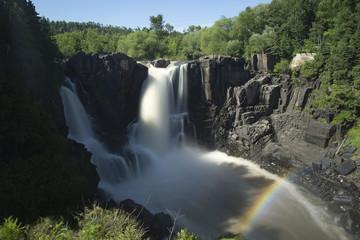 High Falls Waterfall and rainbow, Grand Portage Minnesota