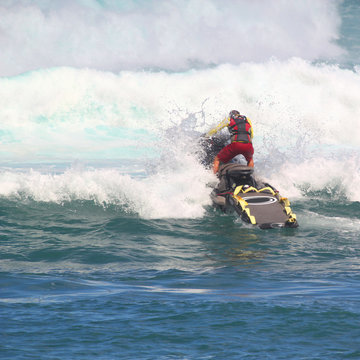MAUI, HAWAII-NOV 10: Unidentified lifeguard on a jet ski practices rescues in heavy winter surf.