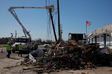 Crews work to repair power lines downed by Hurricane Michael in Springfield
