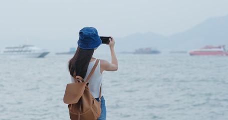 Woman take photo on cellphone