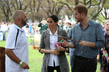 Britain's Prince Harry and his wife Meghan, Duchess of Sussex, attend a community picnic at Victoria Park in Dubbo