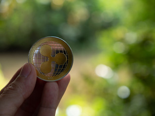 ripple coin and copyspace blur background. money online investment  cryptocurrency concept. selective focus.