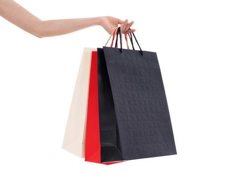 hand holding shopping bag isolated on white background