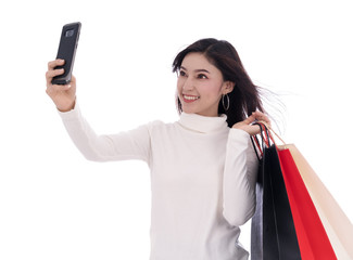 shopping woman using smartphone to taking a selfie isolated on white background