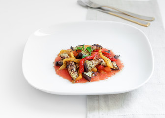 Salad of tomatoes, peppers and roasted aubergine