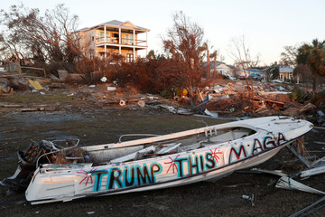 "A ""MAGA"" sign is written on a boat damaged by Hurricane Michael in Mexico Beach"