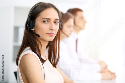 Call Center Operators Focus On Young Cheerful Smiling Woman