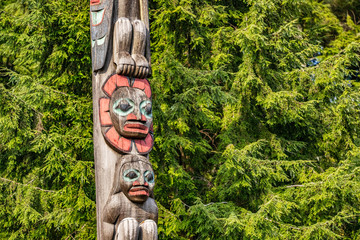 Alaska totem pole in Ketchikan, Alaska. Cruise travel destination vacation. Wood carving, traditional art.