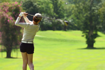 Woman playing golf on a beautiful natural golf course