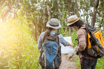 Two Young Tourists With Backpacks Sightseeing nature