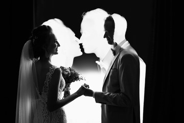 Wedding couple. Multi exposition effect, silhouete of bride and groom. Creative black and white art wedding photo