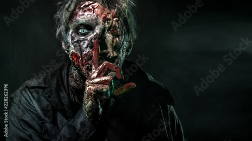Close-up portrait of a horrible scary zombie man. Horror. Halloween 2018