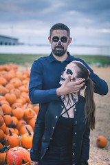 Couple with scary makeup celebrating halloween outdoor
