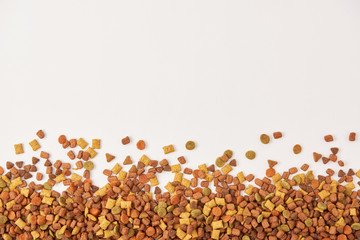 view from above of pile of dog food on white surface Wall mural