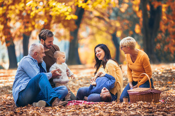 Multl generation family in autumn park having fun