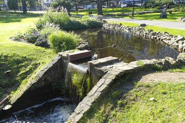 bridge in city garden riga