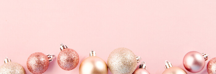 Pink baubles in row on pink