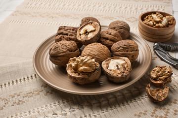 Plate with tasty walnuts on napkin