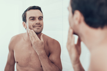 Mirror Reflection of Man Brush Teeth in Bathroom