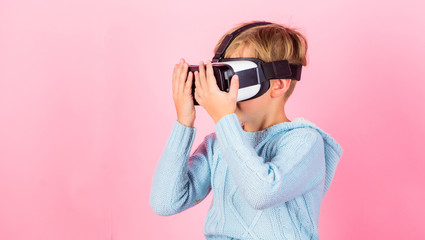 Cyber space and virtual gaming. Virtual reality future technology. Discover virtual reality. Kid boy wear vr glasses pink background. Child boy play virtual reality game. Explore alternative reality