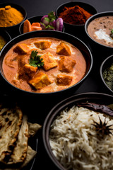 Indian Lunch / Dinner main course food in group includes Paneer Butter Masala, Dal Makhani, Palak Paneer, Roti, Rice etc, Selective focus