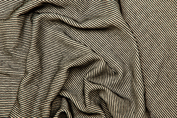 Background and texture. The blurred image of the texture of the fabric for sewing clothes. The combination of colors is black and white. Strip. Cropped shot, isolated, close-up, blurred, horizontal