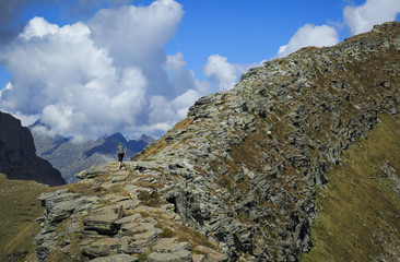 Fotomurales - Hiker on a long ridge in the Ticino mountains. Via Alta Verzasca, Switzerland.