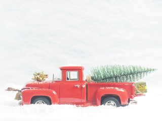 Red vintage truck with a Christmas tree