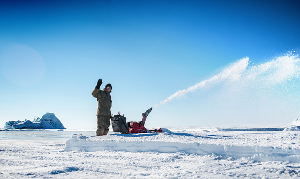 A man cleans the snow with the help of equipment.