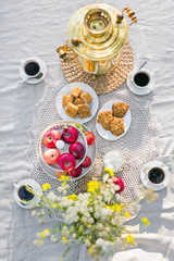 View from above on table with samovar, coffee cups, sweets