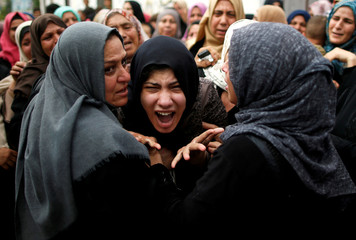 Relative of Palestinian gunman Naji al-Zaneen, who was killed in an Israeli air strike, reacts during his funeral in the northern Gaza Strip