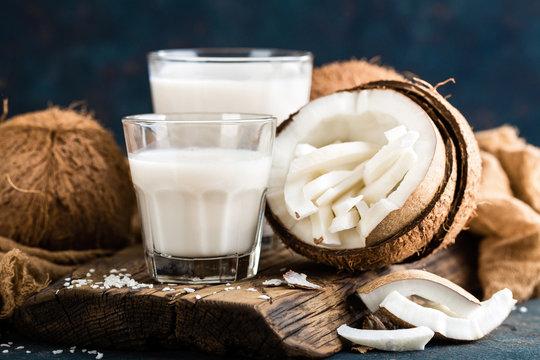 Fresh coconut milk in glass, vegan non dairy healthy drink