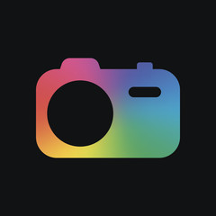 Simple photo camera. Technology icon. Rainbow color and dark background
