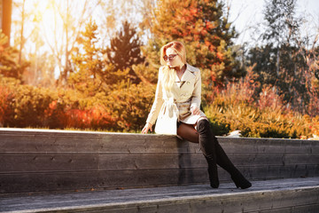 Slim young woman and autumn time.