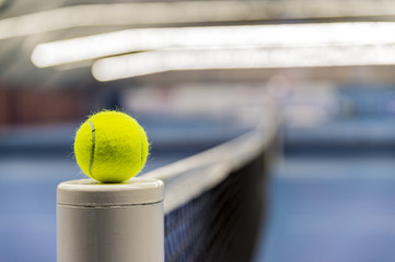 Tennis ball on tennis net