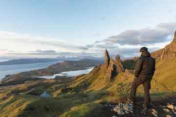 UK, Scotland, Inner Hebrides, Isle of Skye, Trotternish, tourist on peak near The Storr