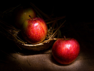Fresh red apples on rustic background