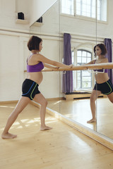 Pregnant woman training in dance studio