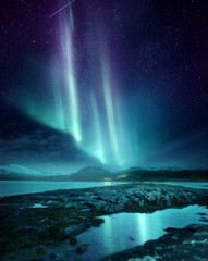 Aluminium Prints Northern lights A spectacular Northern Light Aurora display lighting up the night sky in Northern Norway. A popular destination within the arctic circle for hunting the Northern Lights. Photo Composite.