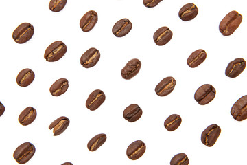 Coffee beans arranged on a white background as texture with copy space