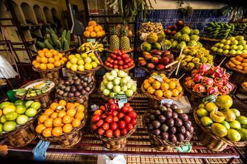 Many fresh and ripe exotic fruits on traditional farmer market Mercado dos Lavradores, Funchal, Madeira island, Portugal Fototapete